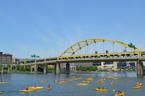 Kayakers on the river photo by Wolfgang Stearns