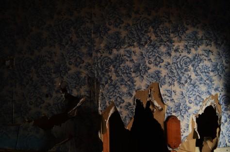 torn blue wallpaper