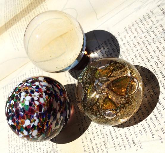 three glass orbs