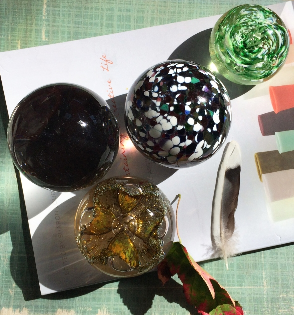 glass orbs and book