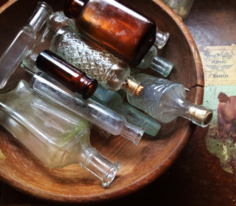bottles in wooden bowl