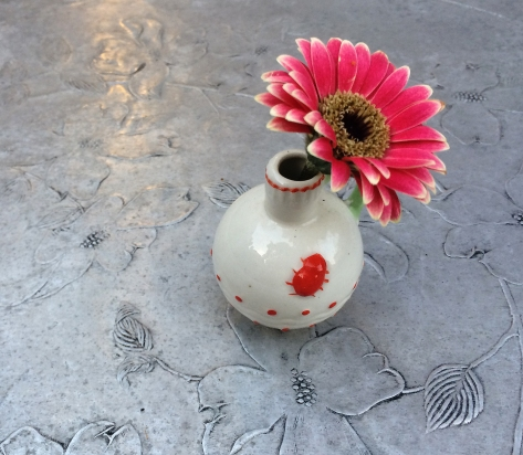 little flower on tin table